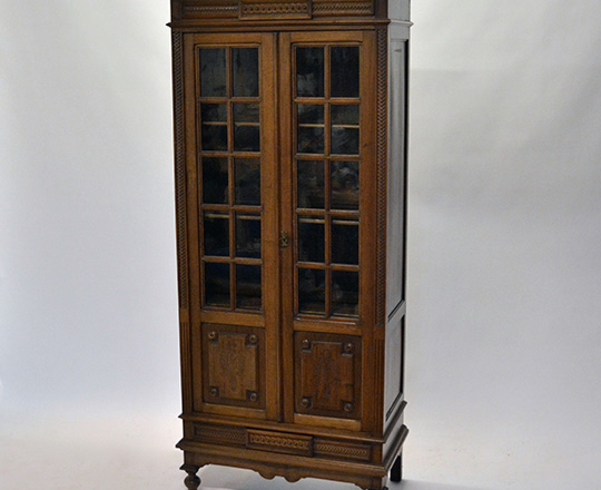 Lot 121: Small turn cent Louis XVI two door country walnut vitrine. H175xW78xD39cm.