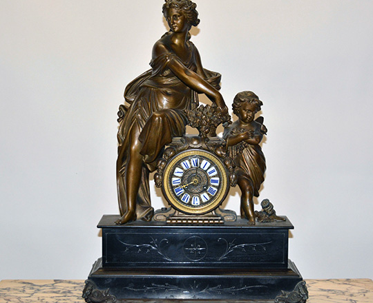 Lot 127: Large 19th cent Nap.lll black marble mantel clock with bronze wash spelter statue of woman and child. H64,5xW47cm.