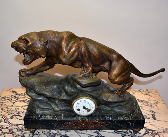 Lot 128_1: Early cent bronze wash spelter mantel clock; lioness signed 'Cartier'. H43xW63cm.
