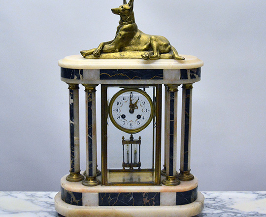Lot 129: Large Art Deco marble and glass cage clock with gilt bronze dog resting on top. H56xW38cm.