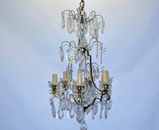 Lot 138: Early cent six light crystal and brass three stage cage chandelier. H93cm