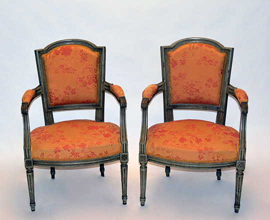 Lot 144: Pr 19th cent painted Louis XVI chairs covered by salmon color floral pattern tissue.