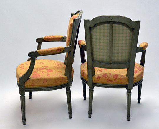Lot 144_1: Pr 19th cent painted Louis XVI chairs covered by salmon color floral pattern tissue.