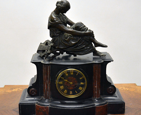 Lot 155: 19th c Nap.lll black/red marble mantel clockwith bronze statue of woman resting by arp. M