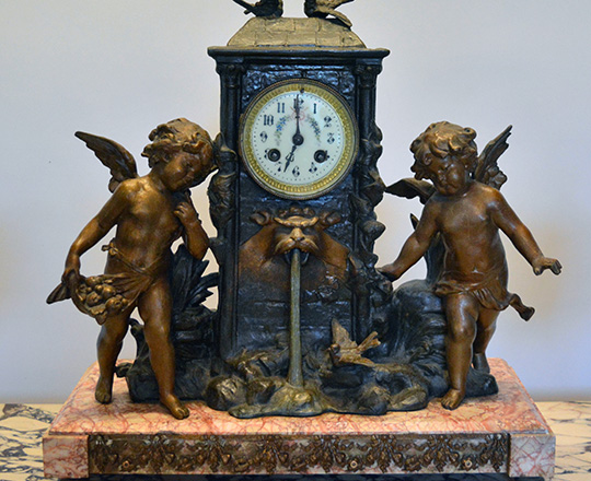 Lot 159_1: 19th c bronze wash spelter clock garniture of two puttis by fountain (of youth?) H41cm and lidded vases H39cm