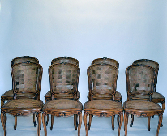 Lot 163: Set of Six caned Louis XV country chairs with X stretcher along with six leather cushions.