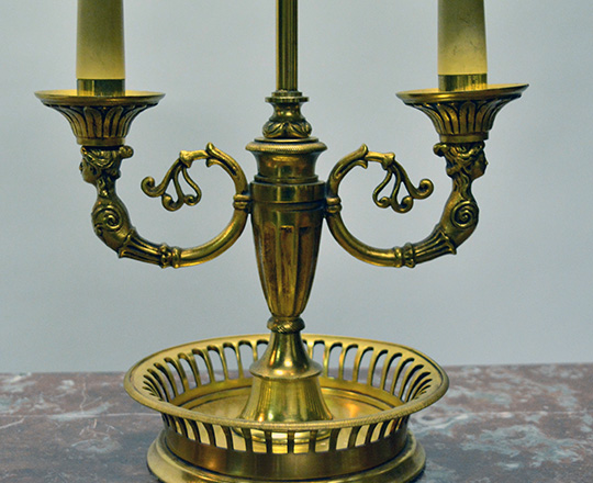 Lot 171_1: Early cent gilt bronze Empire two light 'Bouillotte' table lamp with red painted metal lampshade. H58cm.