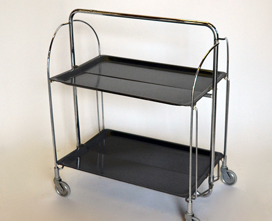 Lot 183: 50's/60's folding bar cart with two platters by Gerlinol. 41 x 60,5cm (platter only).