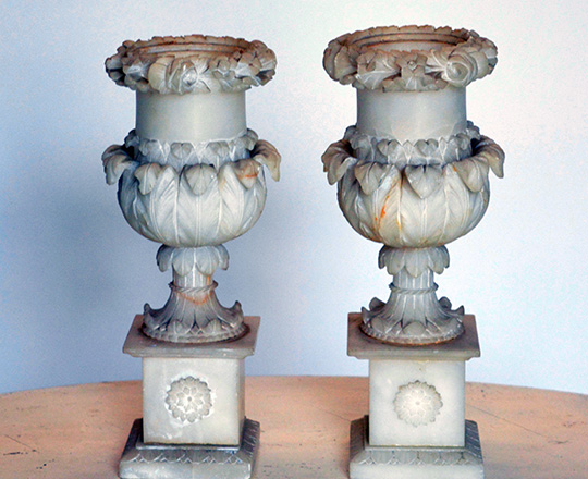 Lot 184: Pair 19th cent Charles X finely sculpted alabaster vases. (acc.) H25,5cm.