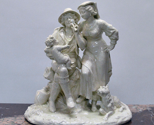 Lot 191: Turn cent, white varnished ceramic statue of couple with child. H 36cm.