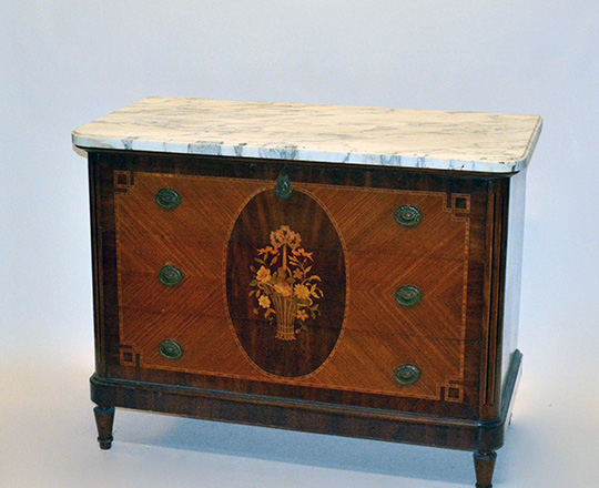 Lot 205: Late 19th cent Louis XVI three drawer, marble top commode with floral marquetry center medallion. H86xW112xD55cm.