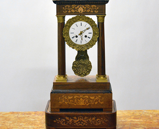 Lot 561: 19thc. Charles X fine marquetry portico clock with a base. H55,5 x W29cm (with base).