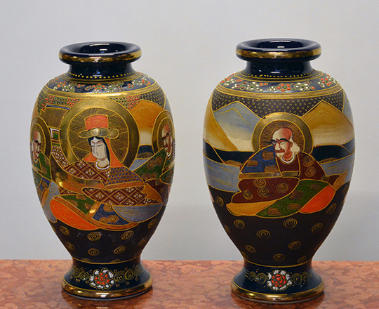 Lot 570: Pair Satsuma vases decorated with various hand painted Japanese characters. H31cm.