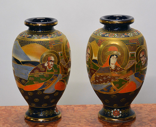 Lot 570_1: Pair Satsuma vases decorated with various hand painted Japanese characters. H31cm.