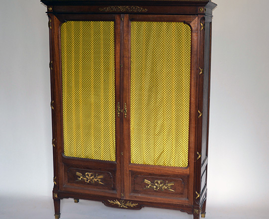 Lot 573: Quality 19th cent Louis XVI two wire mesh door mahogany library by Mercier Freres. H177xW125xD52cm.
