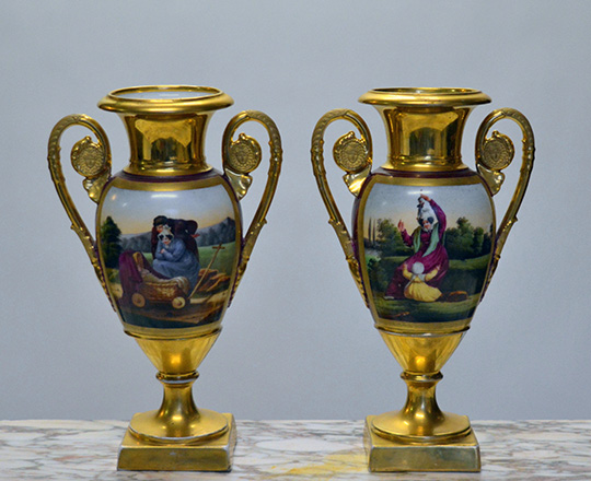 Lot 583: Pair 19th cent gilt porcelain vases with paited family scenes. H 30cm.