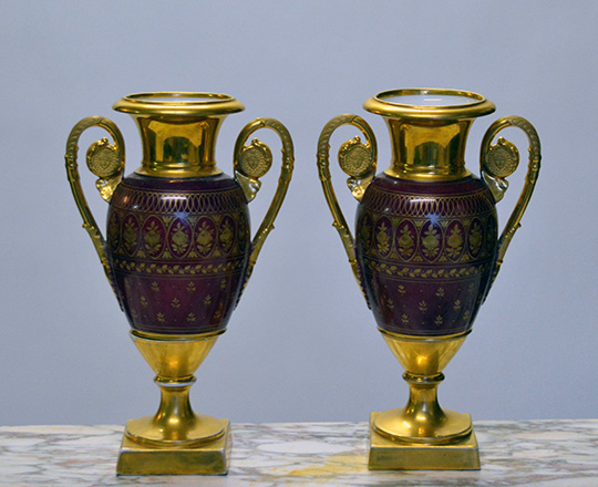 Lot 583_1: Pair 19th cent gilt porcelain vases with paited family scenes. H 30cm.