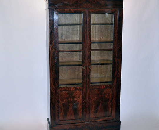 Lot 587: 19th cent Louis Ph two door flamed mahogany vitrine.(some veneer acc. on lower skirt.) H189xW104xD37cm.