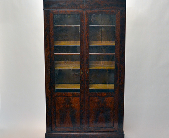 Lot 587_1: 19th cent Louis Ph two door flamed mahogany vitrine.(some veneer acc. on lower skirt.) H189xW104xD37cm.