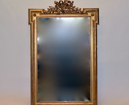 Lot 595: 19th cent Louis XVI gold leaf bevelled mirror with finely ornated pediment.(small acc.& scratches) H146xW95cm.