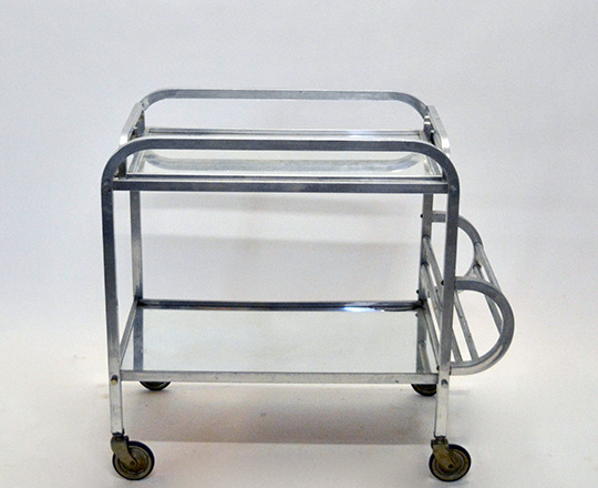 Lot 596_1: Art Deco aluminium bar cart on wheels with removable tray. (acc. on bottom mirror) H76xW72xD40cm.