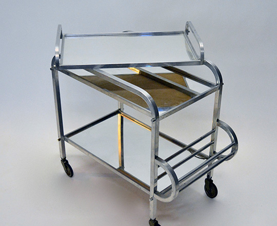 Lot 596_2: Art Deco aluminium bar cart on wheels with removable tray. (acc. on bottom mirror) H76xW72xD40cm.